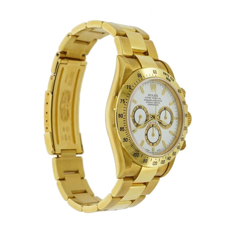 Pre-owned Rolex  Oyster Perpetual Cosmograph Daytona 116508 on 18 karat yellow gold 40 mm case, screw down case back, fixed gold bezel with an engraved tachymetric scale, scratch resistant sapphire crystal, white dial featuring three sub-dials that