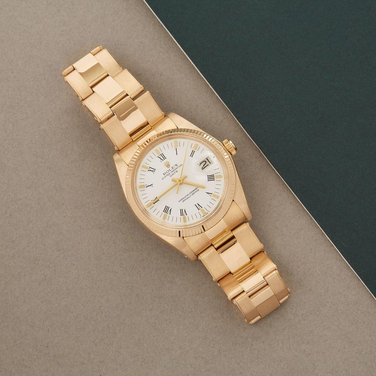 Xupes Reference: W007538 Manufacturer: Rolex Model: Oyster Perpetual Model Variant: Date Model Number: 1503 Age: 1980 Gender: Unisex Complete With: Rolex Box Dial: White Roman Glass: Sapphire Crystal Case Size: 34mm Case Material: Yellow Gold Strap