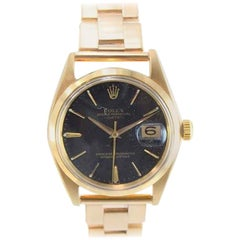 Rolex Oyster Perpetual Date 18 Karat Gold Ref 1500 Rare Black Dial from 1964