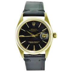 Rolex Oyster Perpetual Date 18 Karat Yellow Gold Original Black Dial from 1964