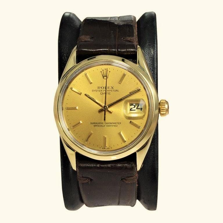 FACTORY / HOUSE: Rolex Watch Company STYLE / REFERENCE: Oyster Perpetual / Date   METAL / MATERIAL: Gold Shell / Gold Filled / Stainless Steel DIMENSIONS: 40mm  X 34mm CIRCA: 1972 MOVEMENT / CALIBER:  26 Jewels / Manual Winding / Cal.  DIAL / HANDS: