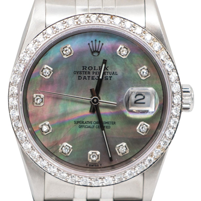 Brand: Rolex  Movement: T Swiss Made T Automatic Movement  Case Diameter: 36 mm  Waterproof to 100 Meters / 330 Feet  Dial: 10 Diamonds With The Rolex Crown Logo At The 12 O'clock Position, 18K White Gold Hour Markers  Bezel Set With 44 Factory