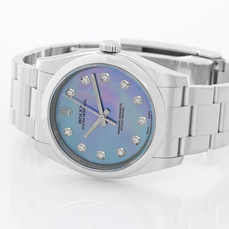 Rolex Oyster Perpetual Men's Stainless Steel Watch 116000 -  Automatic winding, 31 jewels, sapphire crystal. Stainless steel case with smooth bezel (36mm diameter). Custom Blue Mother of Pearl dial with diamond hour markers. Stainless steel Oyster