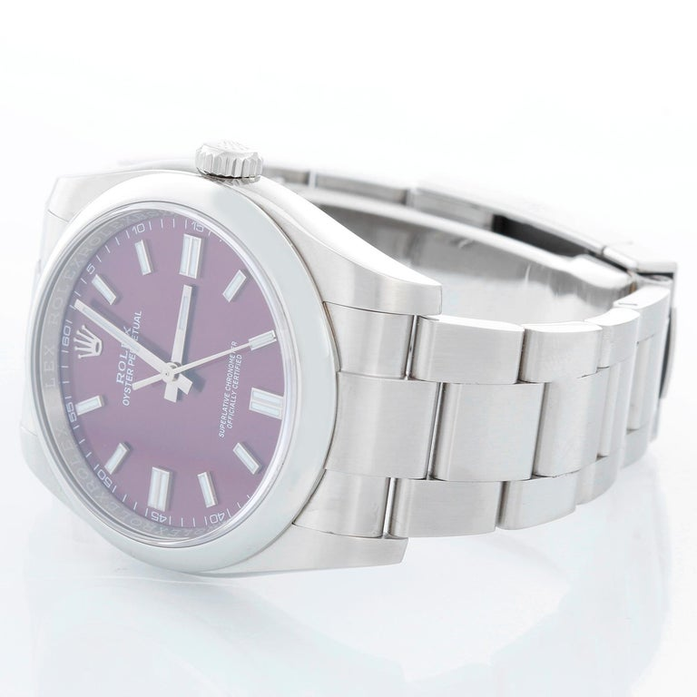 Rolex Oyster Perpetual Men's Stainless Steel Watch 116000 - Automatic winding, 31 jewels, sapphire crystal. Stainless steel case with smooth bezel (36mm diameter). Grape dial with luminous hour markers. Stainless steel Oyster bracelet. Pre-owned