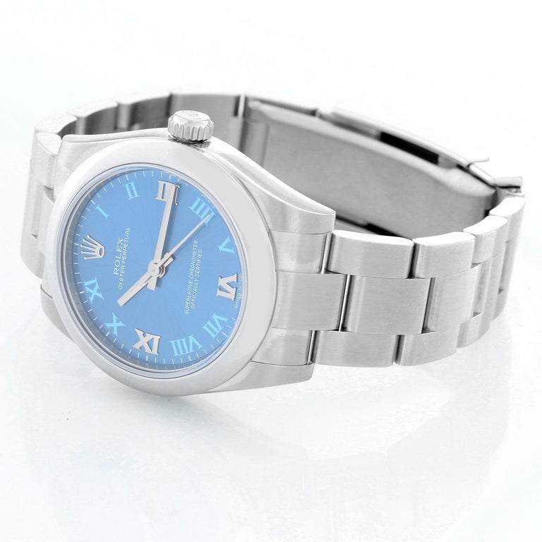 Rolex Oyster Perpetual No-Date Blue Dial Midsize Steel Watch 177200 - Automatic winding. Stainless steel case with smooth bezel ( 31 mm). Blue dial with Roman numerals. Stainless steel Oyster bracelet. Pre-owned with custom box and card. Dated 2014.
