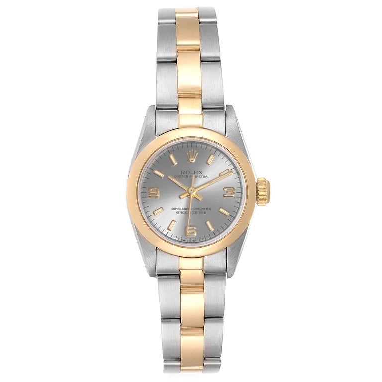 Rolex Oyster Perpetual NonDate Steel Yellow Gold Ladies Watch 67183. Officially certified chronometer self-winding movement. Stainless steel oyster case 24.0 mm in diameter. Rolex logo on a 18k yellow gold crown. 18k yellow gold smooth bezel.