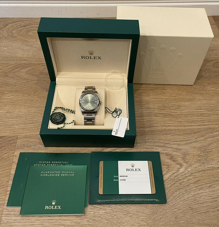 Rolex Oyster Perpetual Olive Green Stainless Steel 34mm Watch 114200 Box & Papers  Specifications BrandRolex Model NameOyster Perpetual Model No.114200 GenderUnisex Case Diameter34mm BoxYes PapersYes  Condition  Excellent  Serial X045XXXX