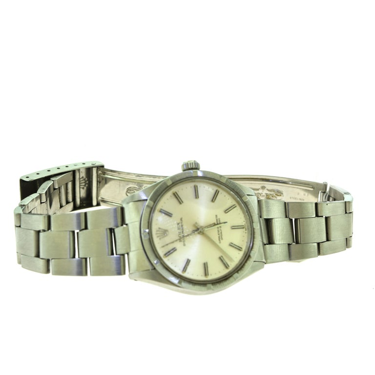 Rolex Oyster Perpetual Ref. 1007 Stainless Steel Champagne Dial Watch 'R-8' In Good Condition For Sale In Miami, FL