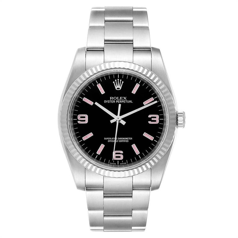 Rolex Oyster Perpetual Steel White Gold Black Dial Watch 116034 Box Card. Officially certified chronometer self-winding movement. Stainless steel case 36.0 mm in diameter. Rolex logo on a crown. 18K white gold fluted bezel. Scratch resistant