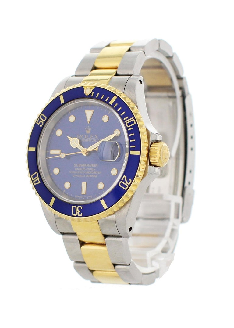 Rolex oyster perpetual Submariner Date 18k 16613 Mens Watch. 40mm Stainless steel case.18k yellow gold bezel with blue bezel insert. Blue dial with gold luminous hands and markers. 18k yellow gold and stainless steel Oyster band. Will fit up to a