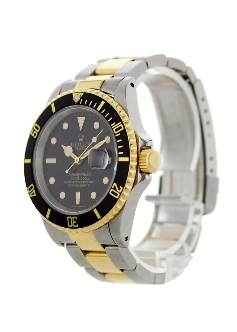 Rolex oyster perpetual Submariner Date 18k 16613 Mens Watch. 40mm Stainless steel case.18k yellow gold bezel with black bezel insert. Black dial with gold luminous hands and markers. 18k yellow gold and stainless steel Oyster band. Stainless steel