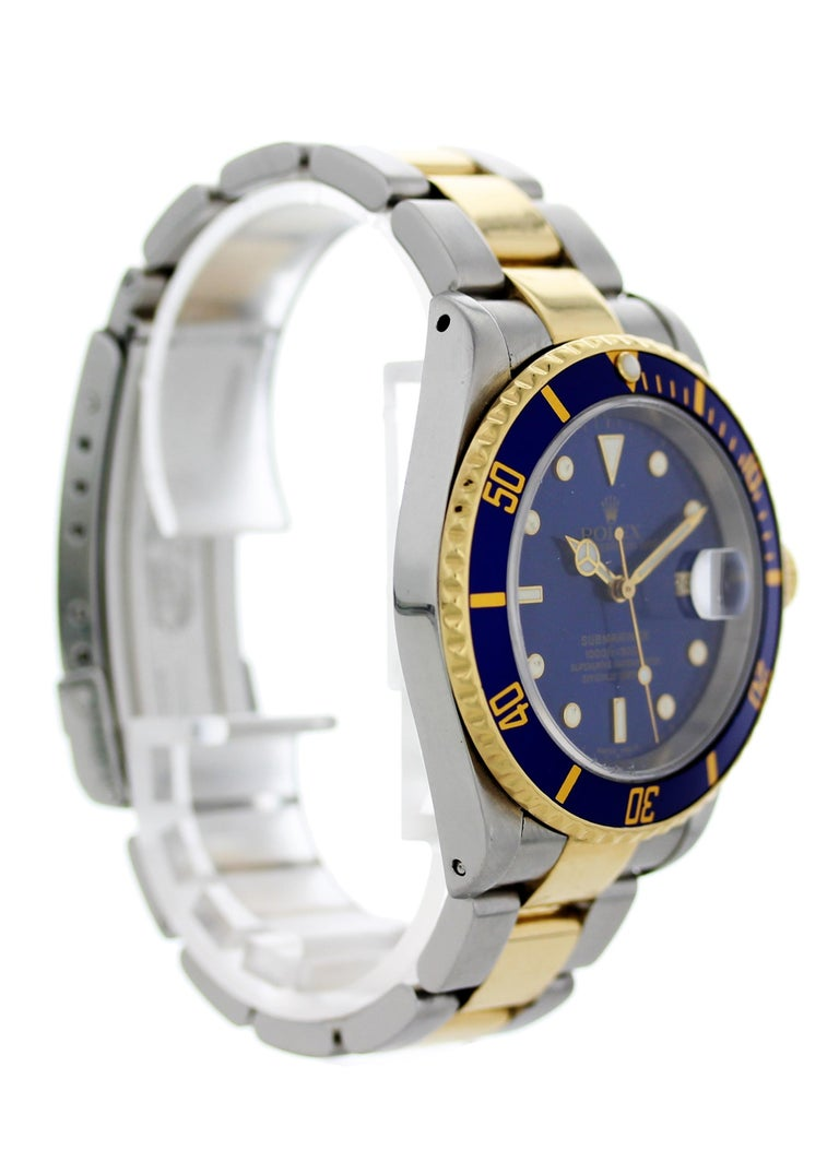 Rolex oyster perpetual Submariner Date 18k 16613 Mens Watch. 40mm Stainless steel case.18k yellow gold bezel with blue bezel insert. Blue dial with gold luminous hands and markers. 18k yellow gold and stainless steel Oyster band. Will fit up to a 7