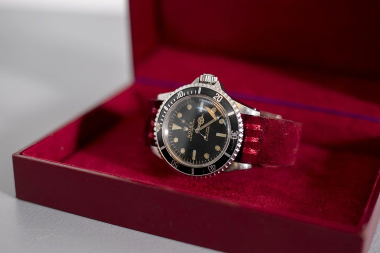 Rare and wonderful self-winding Rolex Oyster Perpetual Submariner from 1963. This gorgeous wristwatch is truly enchanting, it has the dial, black and with underline gold graphics, the case and movement signed Rolex, the black graduated and rotating