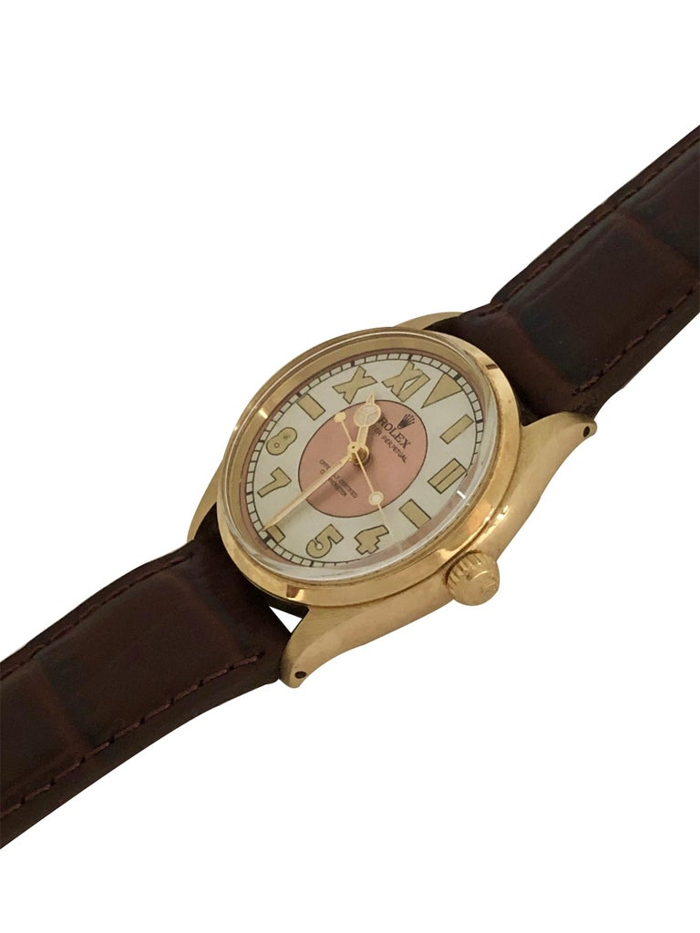 Circa 1945 Rolex Oyster Perpetual Reference 6567 Wrist Watch, 34 M.M 14K yellow Gold 3 piece case with smooth bezel. Caliber 1030 Automatic, self winding Nickle lever movement, Gold Rolex Logo Crown.  Custom Rose and White