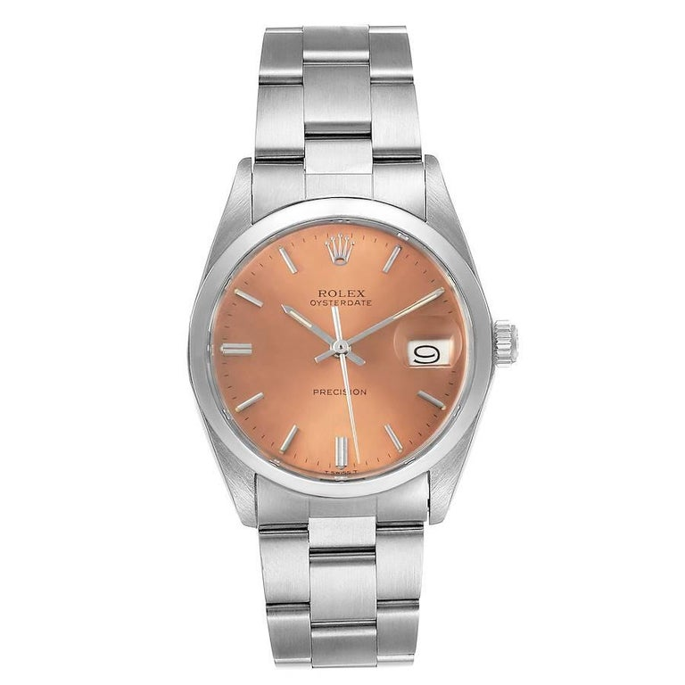 Rolex OysterDate Precision Bronze Dial Steel Vintage Mens Watch 6694. Manual-winding movement. Stainless steel oyster case 35.0 mm in diameter. Rolex logo on a crown. Stainless steel smooth domed bezel. Acrylic crystal with cyclops magnifier. Bronze