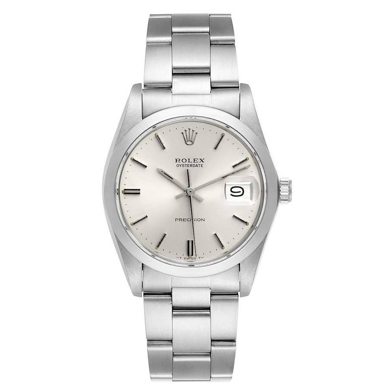 Rolex OysterDate Precision Silver Dial Steel Vintage Mens Watch 6694. Manual-winding movement. Stainless steel oyster case 35.0 mm in diameter. Rolex logo on a crown. Stainless steel smooth domed bezel. Acrylic crystal with cyclops magnifier. Silver