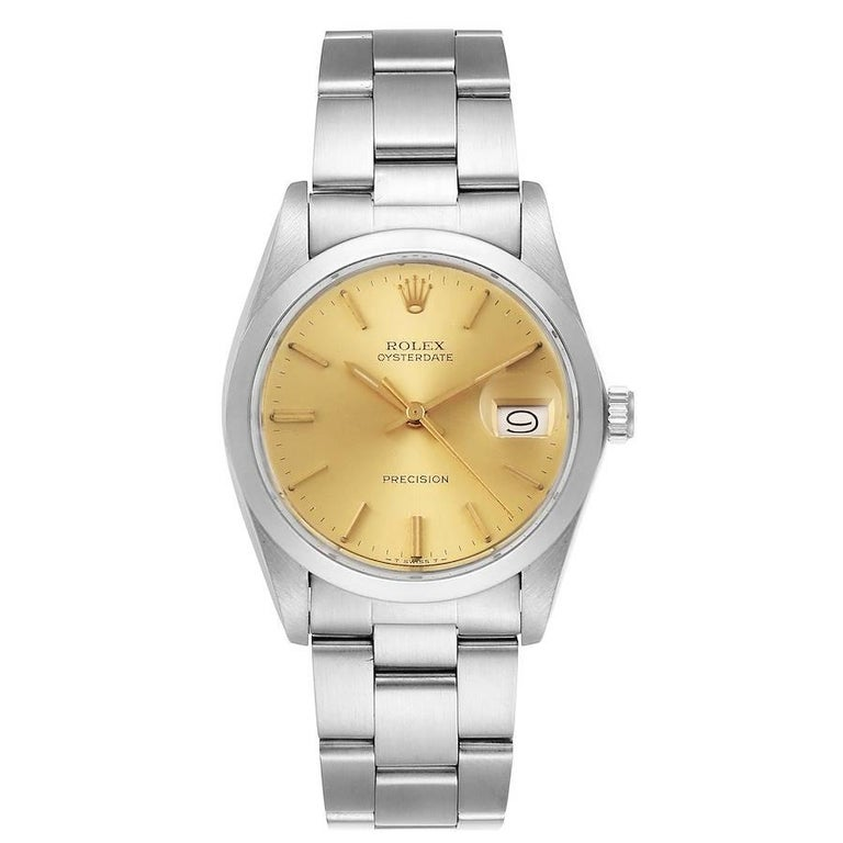 Rolex OysterDate Precision Steel Vintage Mens Watch 6694. Manual-winding movement. Stainless steel oyster case 35.0 mm in diameter. Rolex logo on a crown. Stainless steel smooth domed bezel. Acrylic crystal with cyclops magnifier. Champagne dial