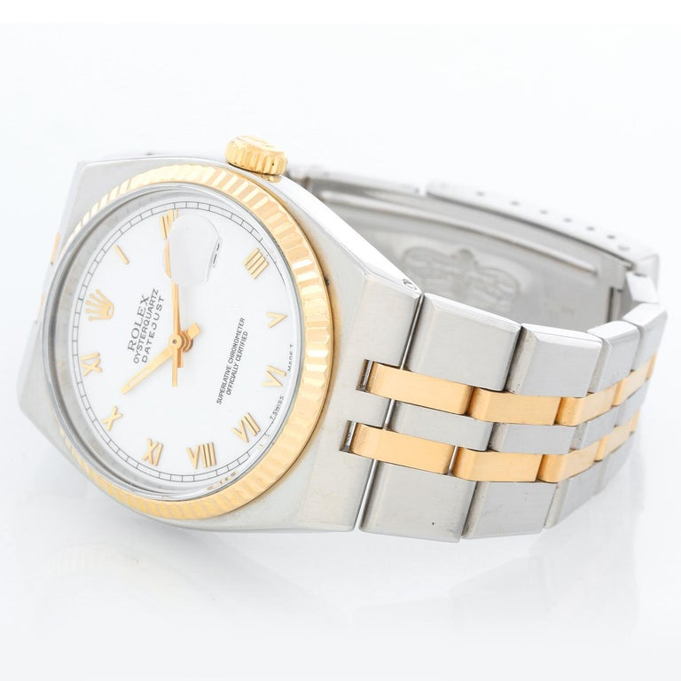 Rolex Oysterquartz Datejust 2-Tone Men's Watch 17013 - Quartz, Quickset date, sapphire crystal. Stainless steel case with yellow gold fluted bezel. White dial with raised gold Roman markers. Stainless steel and yellow gold Oyster bracelet. Pre-owned