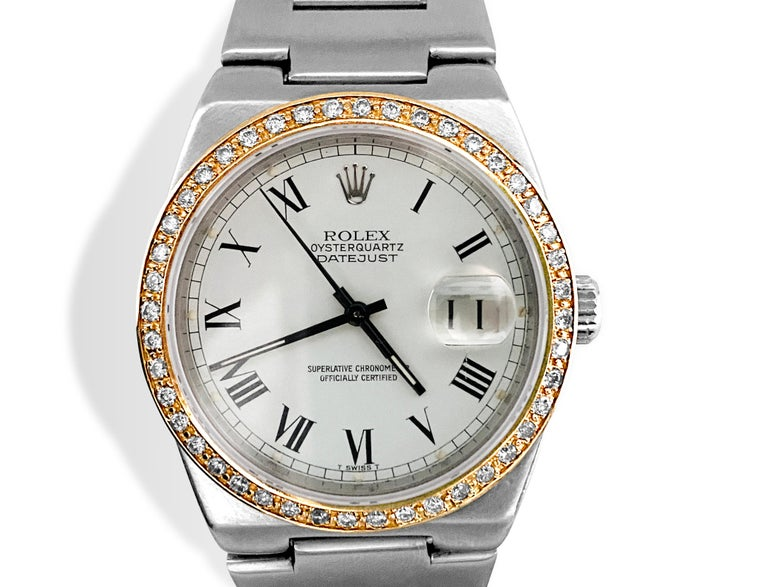 Rolex Oysterquartz Datejust 17000. Rolex Datejust Stainless Steel. 36mm case.   Comes with Diamond Bezel. TCW of diamonds : 1.00 carat. VS2-SI1 clarity and F-G color. All stones are round brilliant cut, set in bead setting.   For 25 years Rolex