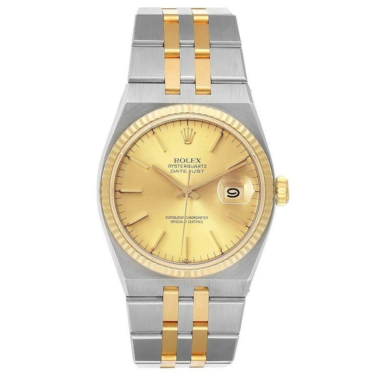 Rolex Oysterquartz Datejust 36mm Steel Yellow Gold Mens Watch 17013. Quartz movement. Stainless steel oyster case 36 mm in diameter. Rolex logo on a crown. 18k yellow gold fluted bezel. Scratch resistant sapphire crystal with cyclops magnifier.