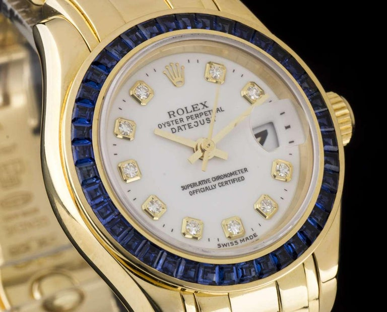 An 18k Yellow Gold Oyster Perpetual Pearlmaster Datejust Ladies Wristwatch, white dial with 10 applied round brilliant cut hour markers, a fixed 18k yellow gold bezel set with 40 baguette cut sapphires  (~1.93ct), an 18k yellow gold pearlmaster