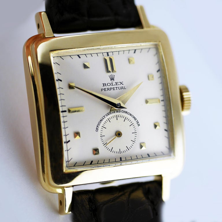 """A rare and very well preserved vintage Automatic Perpetual wristwatch by Rolex Circa 1951.  18ct gold square cushion shaped case marked with Rolex and the """"Rolex Crown"""" lozenge. The snap back 18ct gold case with Swiss hallmarks.  17-Jewel (Rubies)"""