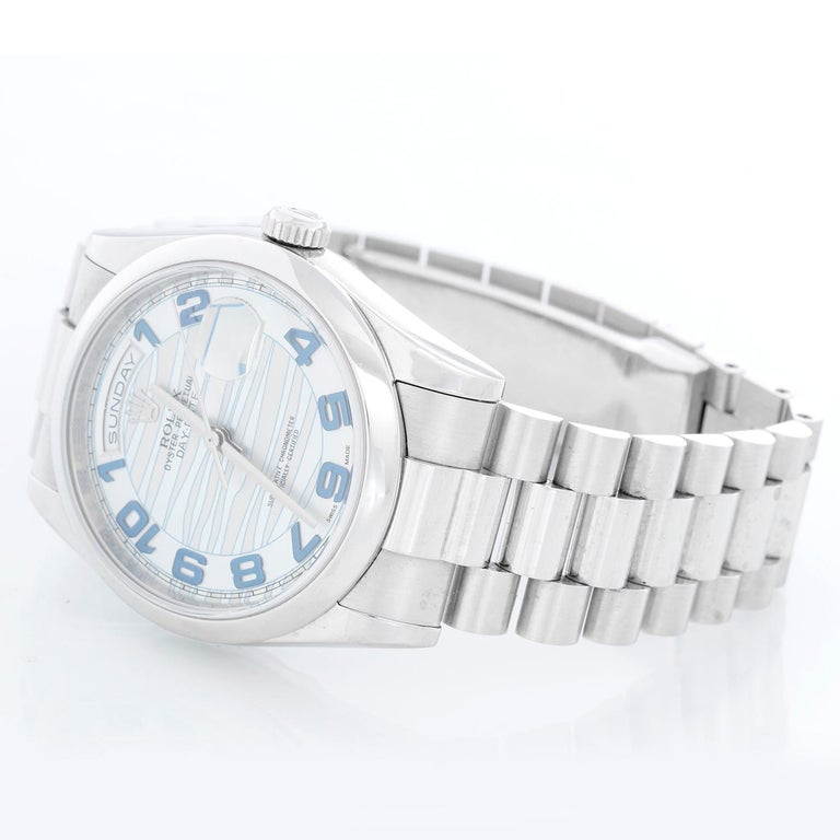 Rolex Platinum President  Day-Date Men's Watch 118206 - Automatic winding, 31 jewels, Quickset, sapphire crystal. Platinum case with smooth bezel . Glacier blue dial . Platinum hidden clasp President bracelet. Pre-owned with box and books.