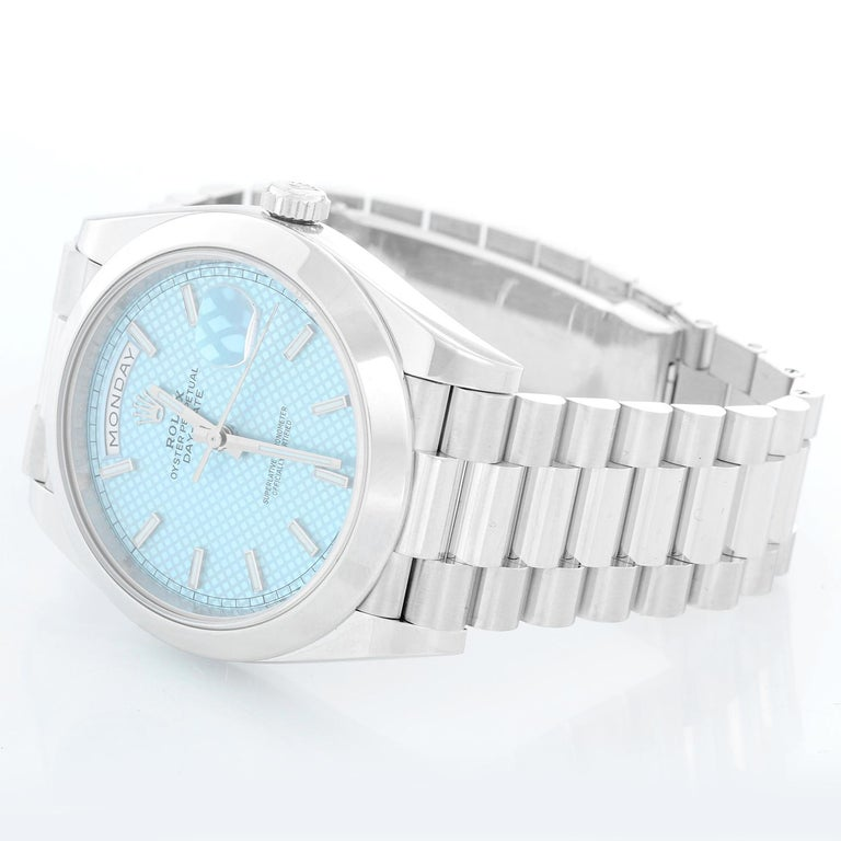 Rolex Platinum President  Day-Date Men's Watch 228206 - Automatic winding, 31 jewels, Quickset, sapphire crystal. Platinum case with smooth bezel ( 40 mm ). Ice Blue with dial markers and diagonal motif. Platinum hidden clasp President bracelet.