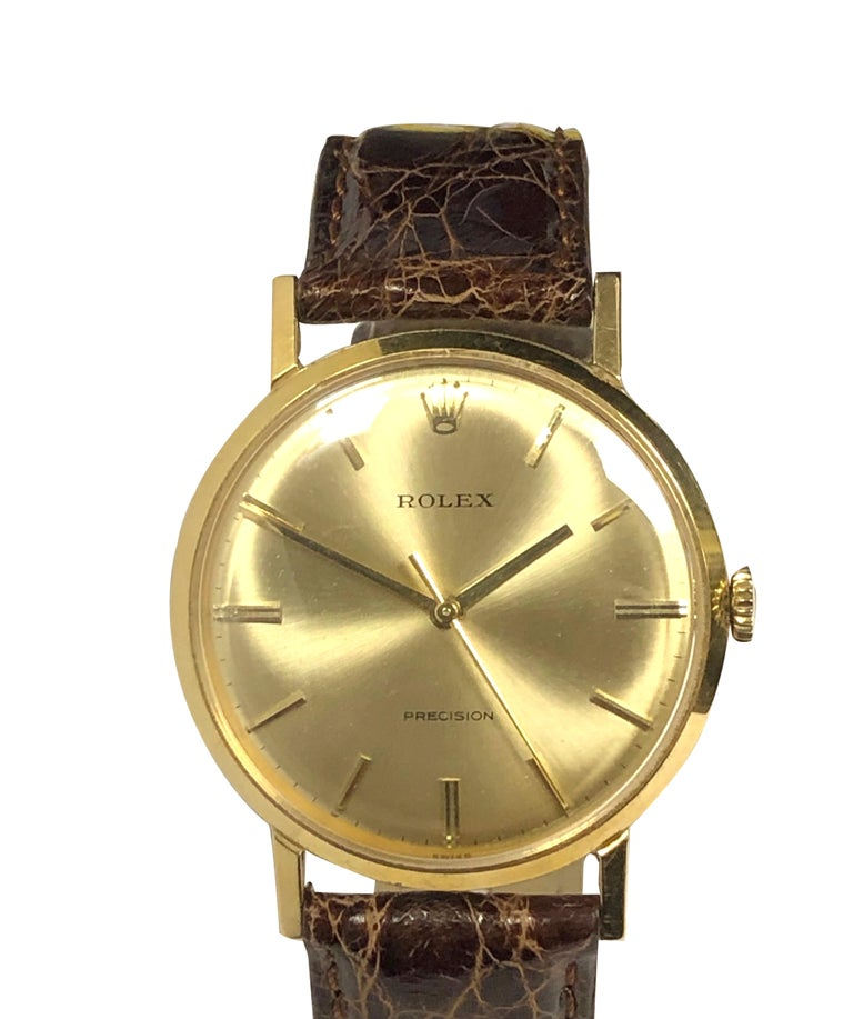 Circa 1950 Rolex Precision, 34 M.M. 18K Yellow Gold 2 Piece case. 17 jewel Nickle Lever mechanical wind movement. original Gold Satin dial with Raised Gold markers and a sweep seconds hand. New Brown Croco padded strap with original Rolex Gold