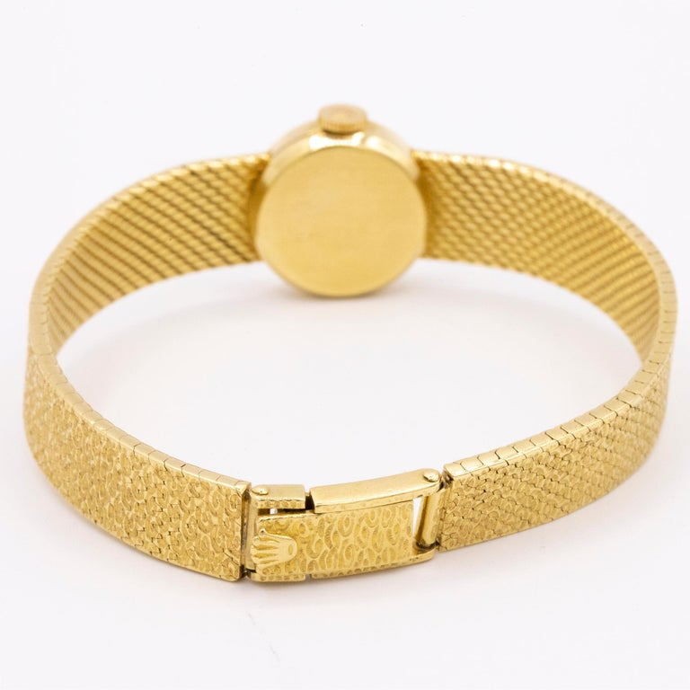 Brand: Rolex Model: Precision Reference: n/a Year: 1940s Material: 18kt Yellow Gold Size: Less than 26mm Crystal: Top Hat style Acrylic  Bracelet: 18kt Yellow Gold texture pressed links