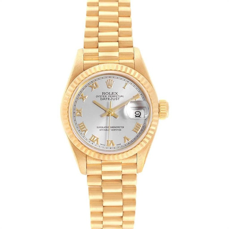 Rolex President Datejust 18K Yellow Gold 26mm Ladies Watch 69178. Officially certified chronometer self-winding movement. 18k yellow gold oyster case 26.0 mm in diameter. Rolex logo on a crown. 18k yellow gold fluted bezel. Scratch resistant