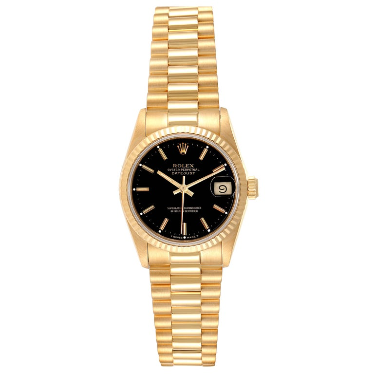 Rolex President Datejust Midsize Black Dial Yellow Gold Ladies Watch 68278. Officially certified chronometer self-winding movement. 18k yellow gold oyster case 31.0 mm in diameter. Rolex logo on a crown. 18k yellow gold fluted bezel. Scratch