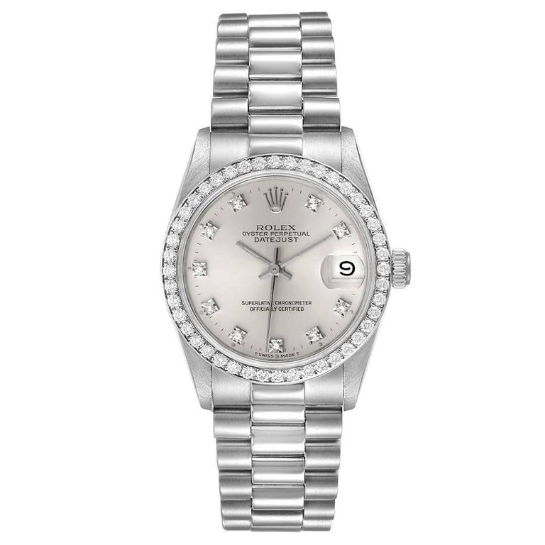 Rolex President Datejust Midsize Platinum Diamond Ladies Watch 68286. Officially certified chronometer self-winding movement. Platinum oyster case 31.0 mm in diameter. Rolex logo on a crown. Original Rolex factory diamond bezel. Scratch resistant