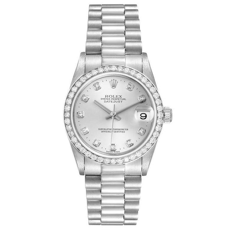 Rolex President Datejust Midsize Platinum Diamond Ladies Watch 78286. Officially certified chronometer self-winding movement. Platinum oyster case 31.0 mm in diameter. Rolex logo on a crown. Original Rolex factory diamond bezel. Scratch resistant