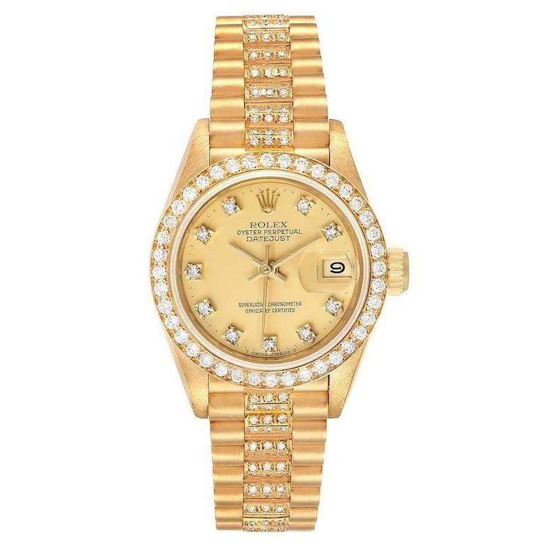 Rolex President Datejust Yellow Gold Diamond Ladies Watch 69138. Officially certified chronometer self-winding movement. 18k yellow gold oyster case 26.0 mm in diameter. Rolex logo on a crown. Original Rolex factory diamond bezel. Scratch resistant