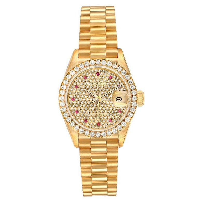 Rolex President Datejust Yellow Gold Diamond Rubies Ladies Watch 69138. Officially certified chronometer self-winding movement. 18k yellow gold oyster case 26.0 mm in diameter. Rolex logo on a crown. Original Rolex 18k yellow gold diamond bezel.