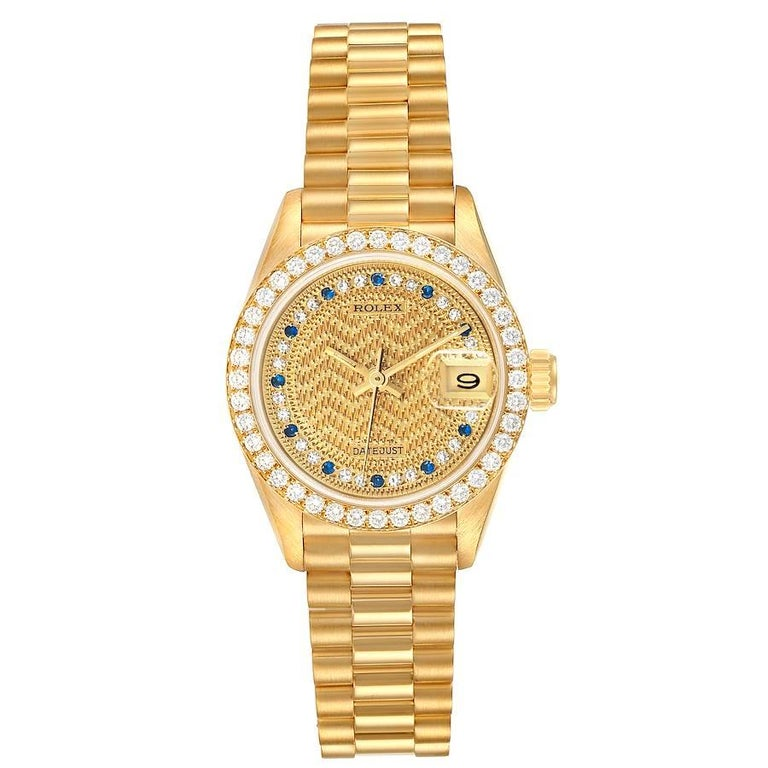 Rolex President Datejust Yellow Gold Diamond Sapphires Ladies Watch 69138. Officially certified chronometer self-winding movement. 18k yellow gold oyster case 26.0 mm in diameter. Rolex logo on a crown. Original Rolex 18k yellow gold diamond bezel.