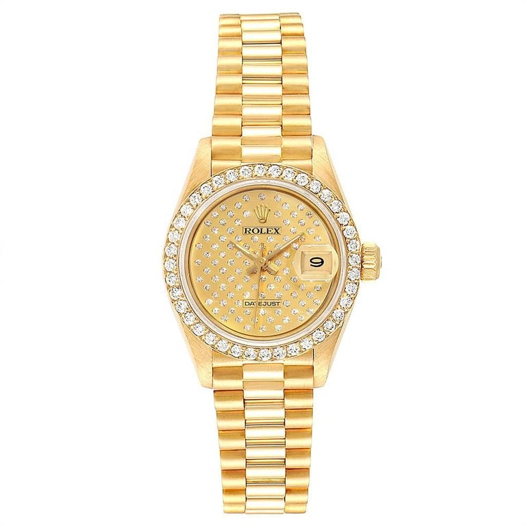 Rolex President Datejust Yellow Gold Pave Diamond Ladies Watch 69138. Officially certified chronometer automatic self-winding movement. 18k yellow gold oyster case 26.0 mm in diameter. Rolex logo on a crown. Original Rolex factory diamond bezel.