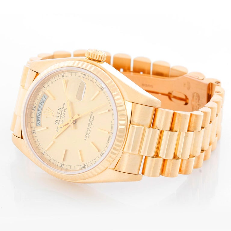 Rolex President Day-Date 18k Yellow Gold Men's Watch 18038 - Automatic winding; quick-set; sapphire crystal. 18k yellow gold case with fluted bezel  (36mm diameter). Champagne dial with stick hour markers . 18k yellow gold President bracelet.