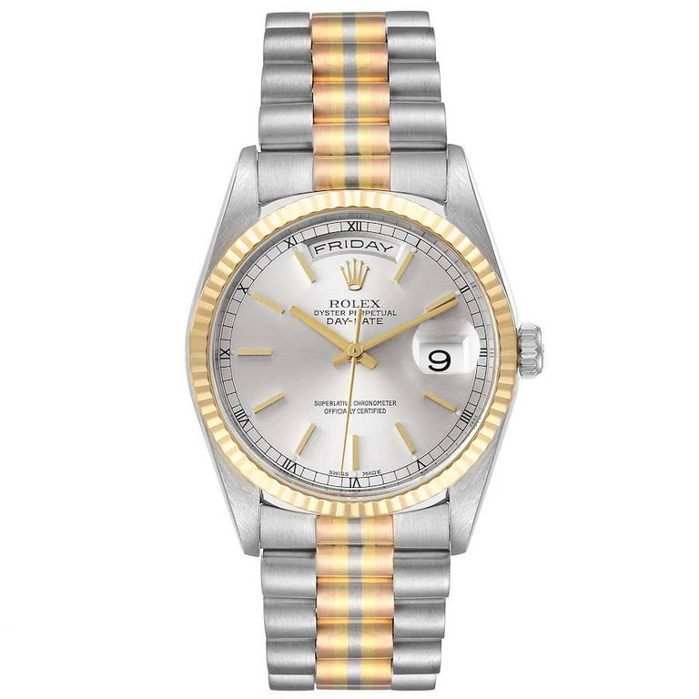 Rolex President Day-Date Tridor White Yellow Rose Gold Mens Watch 18239. Officially certified chronometer self-winding movement. 18k white gold oyster case 36.0 mm in diameter. Rolex logo on a crown. 18k yellow gold fluted bezel. Scratch resistant