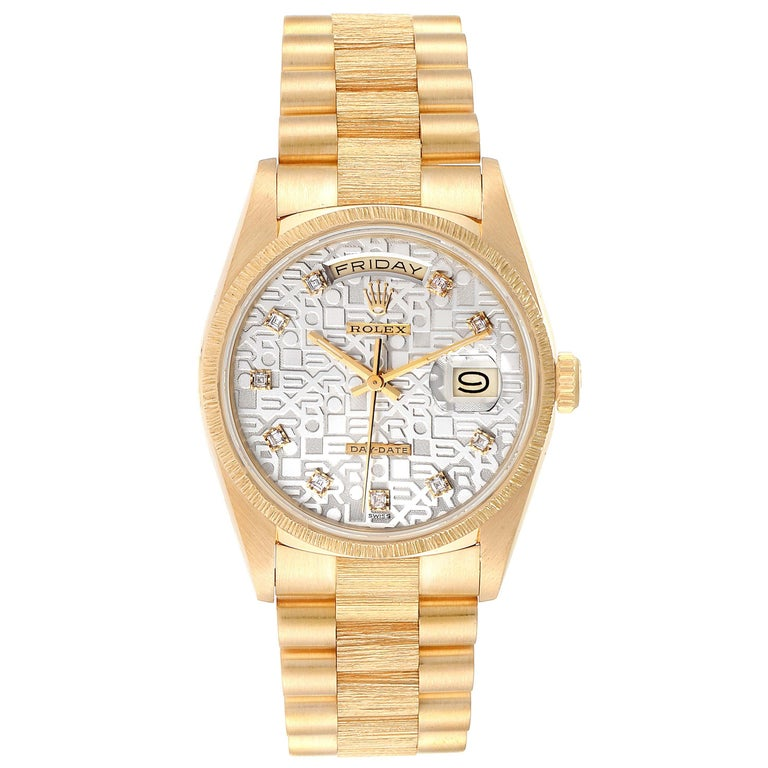 Rolex President Day-Date Yellow Gold Bark Finish Diamond Mens Watch 18248. Officially certified chronometer self-winding movement. 18k yellow gold oyster case 36.0 mm in diameter. Rolex logo on a crown. 18k yellow gold bark finish bezel. Scratch