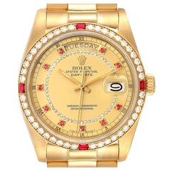 Rolex President Day-Date Yellow Gold String Diamond Ruby Dial Watch 18148
