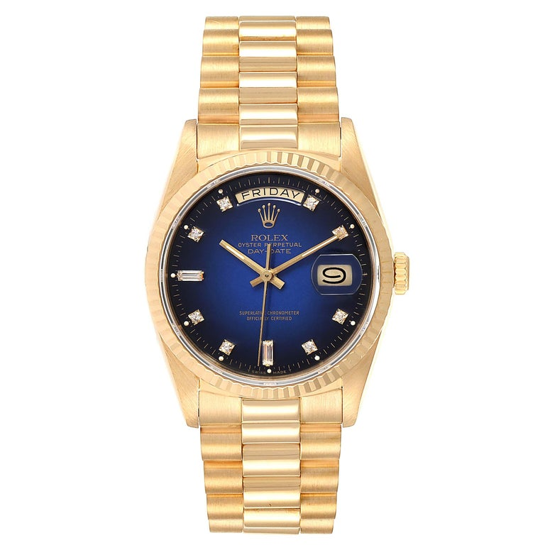 Rolex President Day-Date Yellow Gold Vignette Diamond Mens Watch 18238. Officially certified chronometer self-winding movement. 18k yellow gold oyster case 36.0 mm in diameter. Rolex logo on a crown. 18K yellow gold fluted bezel. Scratch resistant