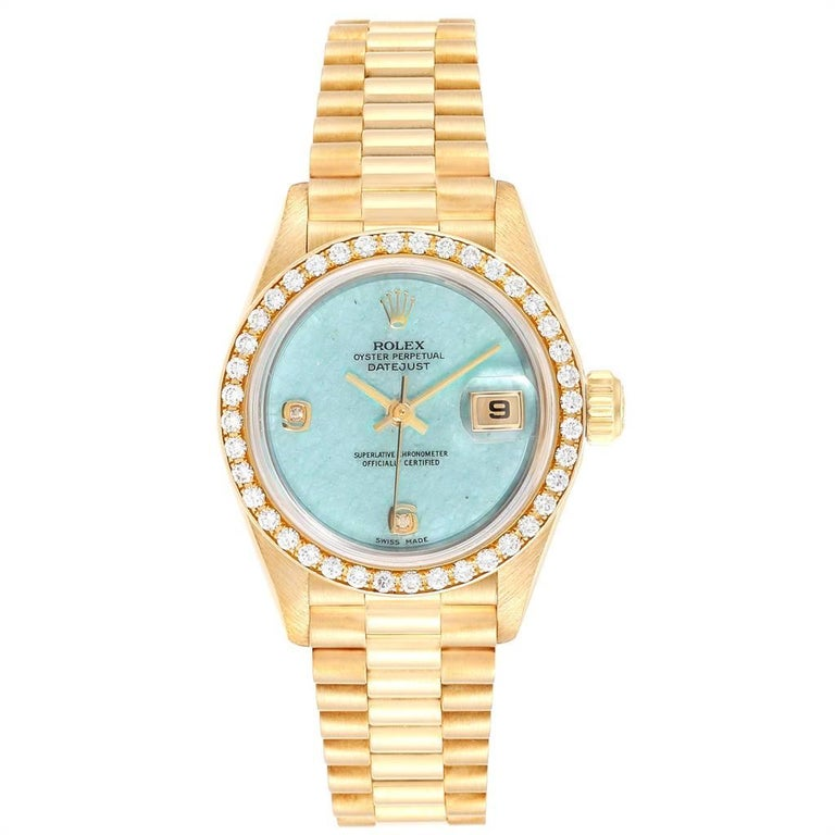 Rolex President Yellow Gold Blue Jadeite Diamond Ladies Watch 69178. Officially certified chronometer self-winding movement with quickset date function. 18k yellow gold oyster case 26.0 mm in diameter. Rolex logo on a crown. Original Rolex factory