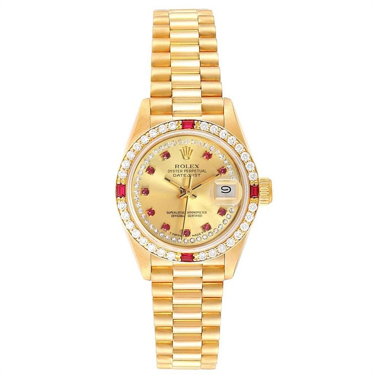Rolex President Yellow Gold String Dial Diamond Ruby Ladies Watch 69068. Officially certified chronometer self-winding movement. 18k yellow gold oyster case 26.0 mm in diameter. Rolex logo on a crown. Original Rolex factory diamond and ruby bezel.