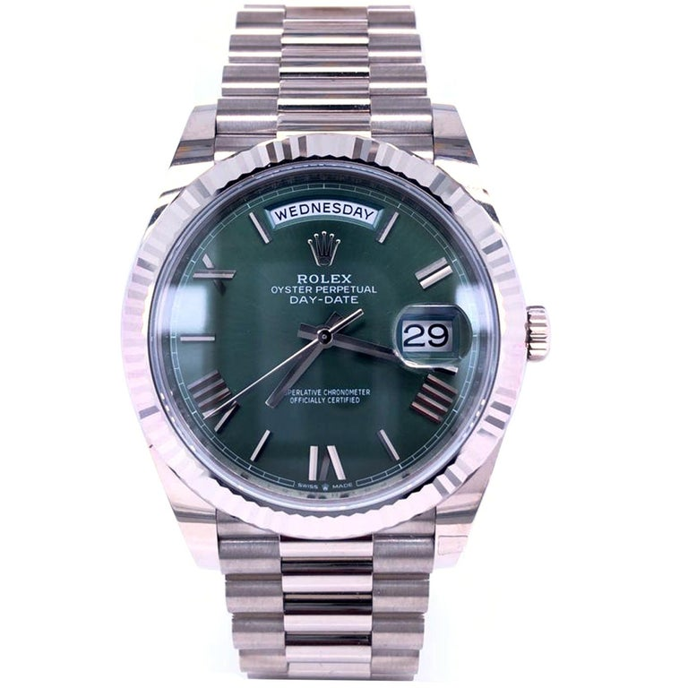 The Oyster Perpetual Day-Date 40 in 18 ct white gold with an olive green dial, fluted bezel, and a President bracelet. The Day-Date was the first watch to indicate the day of the week spelled out in full when it was first presented in 1956. The