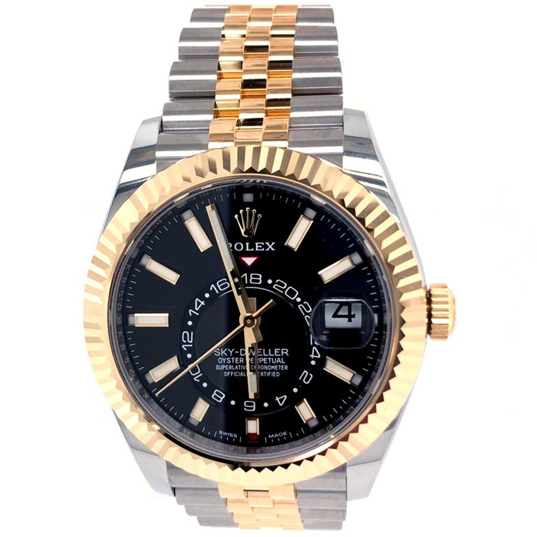 The Oyster Perpetual Sky-Dweller in Oystersteel and yellow gold with a Black dial and an Oyster bracelet. This distinctive watch is characterized by its second-time zone display on an off-center disc on the dial. Furthermore, its innovative system