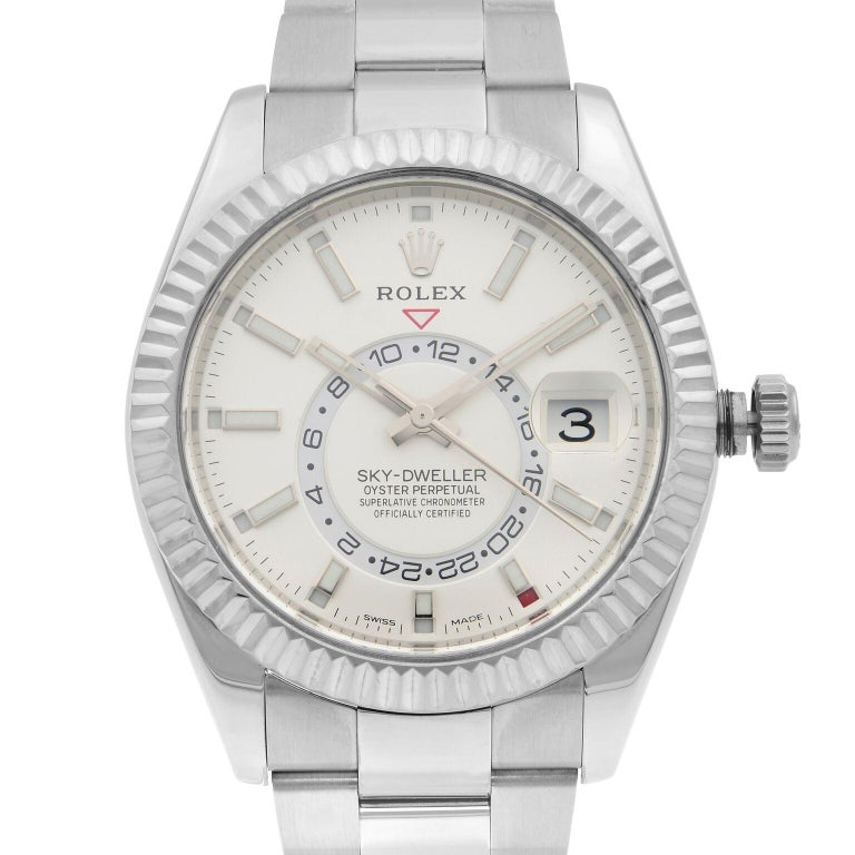 This pre-owned Rolex Sky-Dweller 326934WSO is a beautiful men's timepiece that is powered by mechanical (automatic) movement which is cased in a stainless steel case. It has a round shape face, day indicator, gmt dial and has hand sticks style