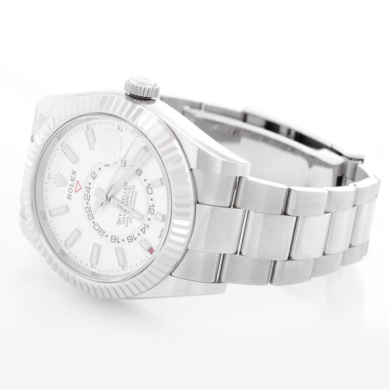 Rolex Sky-Dweller Stainless Steel White Dial 326934 - Automatic, Quickset. Stainless Steel with 18K White gold fluted bezel ( 42 mm ). White dial with index hour markers; date, month, second timezone. Stainless steel with folding clasp. Unused with