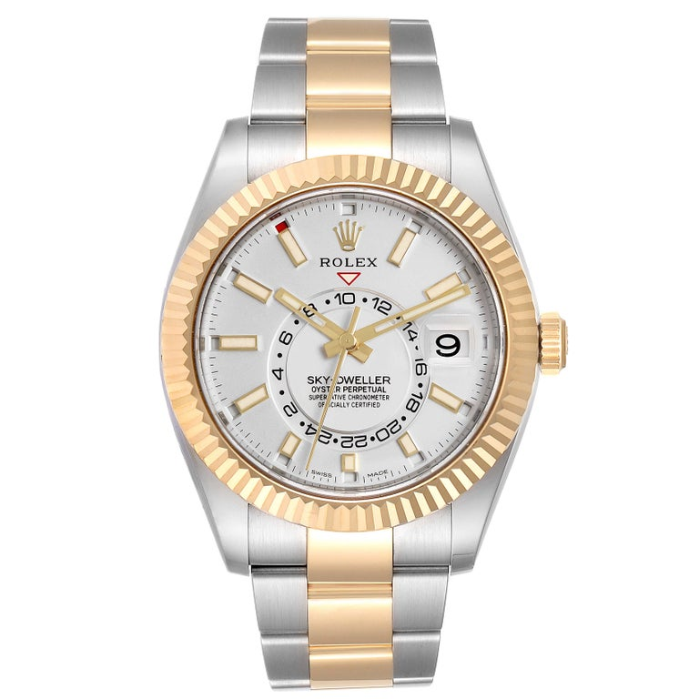Rolex Sky Dweller Yellow Gold Steel White Dial Mens Watch 326933 Unworn. Officially certified chronometer self-winding movement. Dual time zones, annual calendar. Paramagnetic blue Parachrom hairspring. High-performance Paraflex shock absorbers.